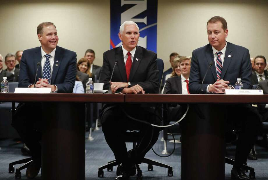 "Vice President Mike Pence, center, speaks during a meeting with Jim Briddentine, left, NASA administration, Jeffrey DeWit, right, NASA CFO and other NASA officials, Monday, April 23, 201<div class=""e3lan e3lan-in-post1""><script async src=""//pagead2.googlesyndication.com/pagead/js/adsbygoogle.js""></script>