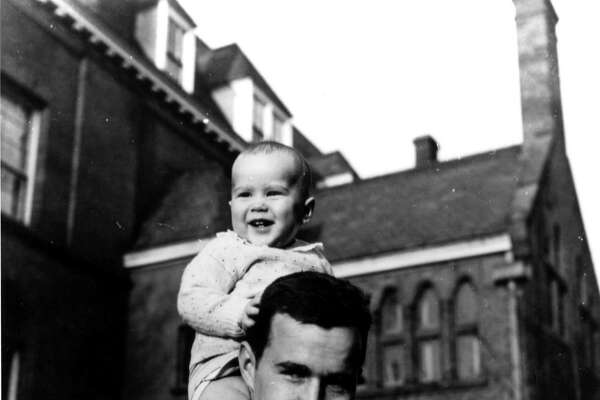 H075-03     George W. Bush sits on his father's shoulders in New Haven, CT., 10 Apr 47. Photo Credit:  George Bush Presidential Library and Museum