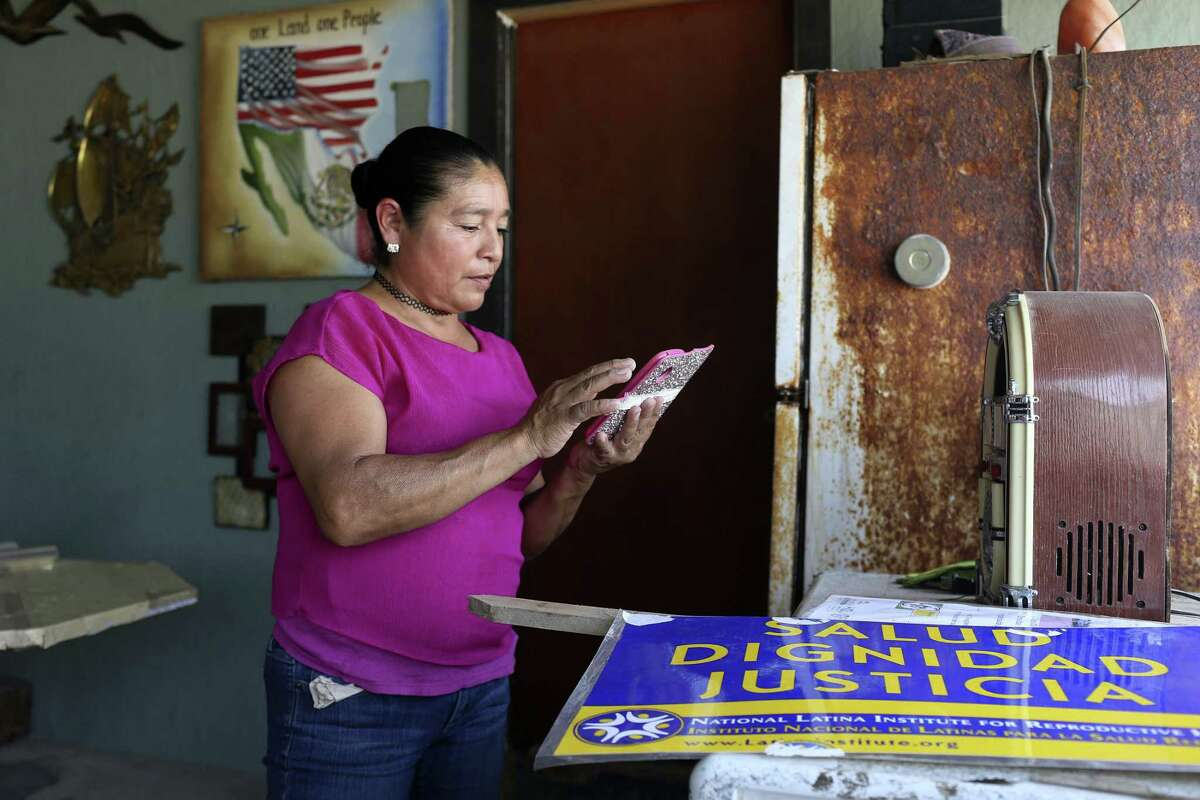 """Eva Chavez, 50, prepares for a health fair at her home near Alton, Texas, Monday, March 26, 2018. Chavez is a volunteer with the National Latina Institute for Reproductive Health community program, """"Soy Ponderosa,"""" (I Am Powerful). Early on February 14th, U.S. Immigration and Customs Enforcement officers detained her at her home. They were looking for her husband. She was released late in the afternoon the same day. Chavez has been in the country for nearly 20 years. And takes care of her 11-year-old special needs son. She was planning on hosting a health clinic on the day of her detention. It was the first clinic held since her detention and was scheduled for March 28."""