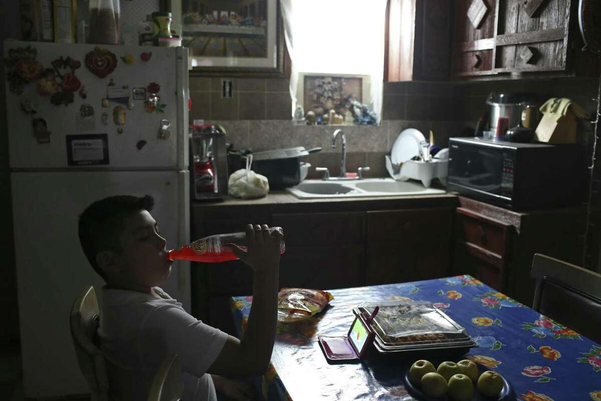 After school, 11-year-old Jorge Cervantes drinks a soda at his home in Alton, Texas, Monday, March 26, 2018. Early on February 14th, U.S. Immigration and Customs Enforcement officers detained his mother, Eva Chavez, 50, at their home. They were looking for her husband. She was released late in the afternoon the same day. Chavez has been in the country for nearly 20 years and takes care of Cervantes, who is special needs child. Chavez is on regular check-ins with U.S. Citizenship and Immigration Services. Her next date is June and she fears deportation.