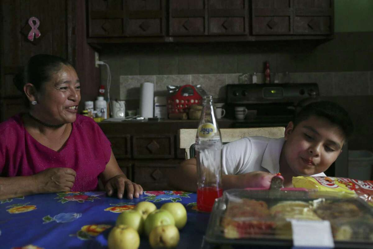 Eva Chavez, 50, talks with her son, 11-year-old Jorge Cervantes, at their home in Alton, Texas, Monday, March 26, 2018. Early on February 14th, U.S. Immigration and Customs Enforcement officers detained his mother, Eva Chavez, 50, at their home. They were looking for her husband. She was released late in the afternoon the same day. Chavez has been in the country for nearly 20 years and takes care of Cervantes, who is special needs child. Chavez is on regular check-ins with U.S. Citizenship and Immigration Services. Her next date is June and she fears deportation.