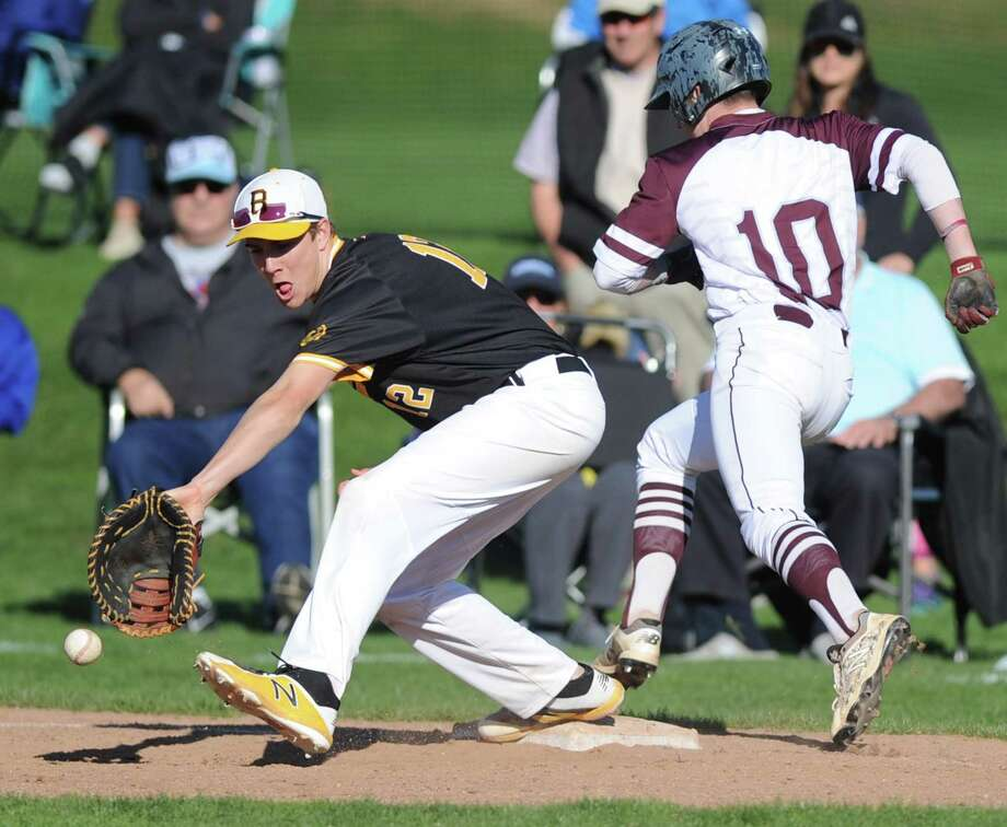 Brunswick first baseman Jake Hyde attempts to scoop the ball as Hopkins' Jake Rizzuti beats the throw in the high school baseball game between Brunswick and Hopkins at Brunswick School in Greenwich, Conn. Monday, April 23, 2018. Photo: Tyler Sizemore / Hearst Connecticut Media / Greenwich Time