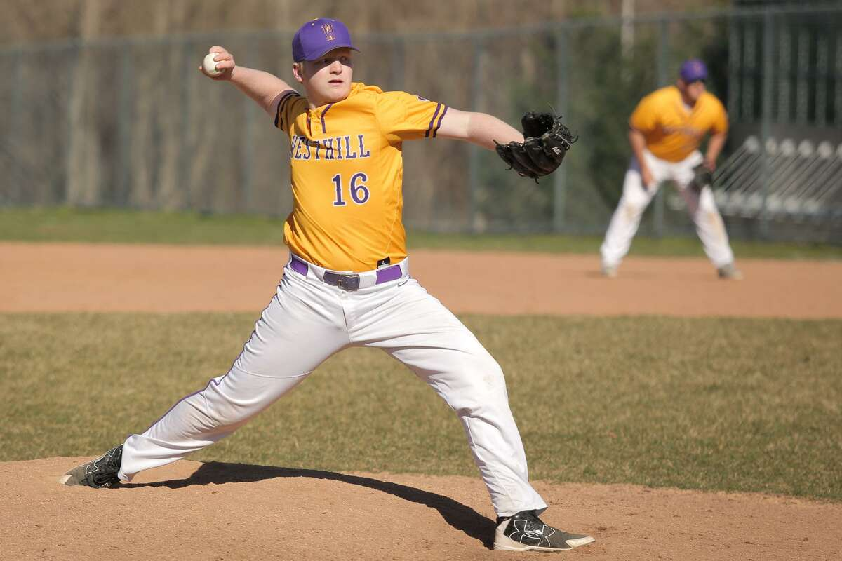 Ryan Carroll throws a pitch during Westhill's victory over Trinity Catholic at Westhill High School in Stamford, Conn. on Monday, April 23, 2018.