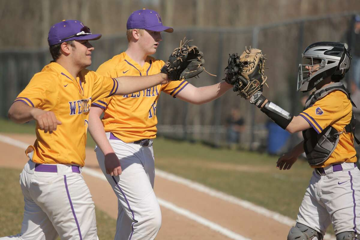 Westhill players celebrate a successful first inning during Westhill's victory over Trinity Catholic at Westhill High School in Stamford, Conn. on Monday, April 23, 2018.