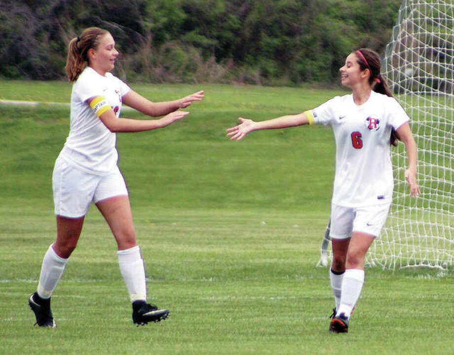 Roxana's Emma Lucas, left, is congratulated by teammate Mykala Lucas after Lucas scored the first of three goals in Monday's 3-3 nonconference tie with rival Civic Memorial at the Wood River Soccer Park. Photo:     Pete Hayes | The Telegraph
