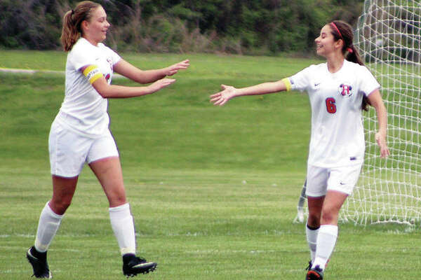 Roxana's Emma Lucas, left, is congratulated by teammate Mykala Lucas after Lucas scored the first of three goals in Monday's 3-3 nonconference tie with rival Civic Memorial at the Wood River Soccer Park.