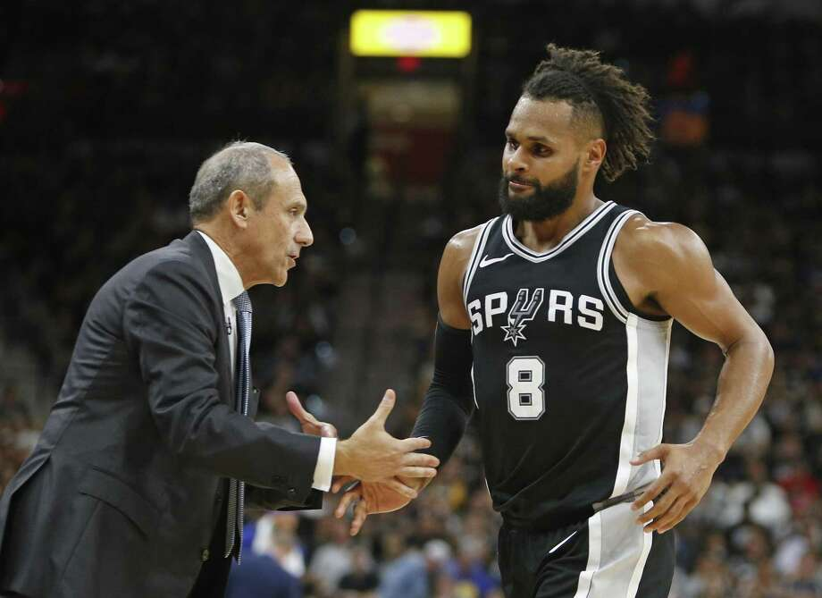 SAN ANTONIO,TX - APRIL 22 :  Ettore Messina greets Patty Mills #8 of the San Antonio Spurs during the game against the Golden State Warriors in the second half of Game Four of Round One of the 2018 NBA Playoffs  at AT&T Center on April 22 , 2018  in San Antonio, Texas.  NOTE TO USER: User expressly acknowledges and agrees that , by downloading and or using this photograph, User is consenting to the terms and conditions of the Getty Images License Agreement. (Photo by Ronald Cortes/Getty Images) Photo: Ronald Cortes, Stringer / Getty Images / 2018 Getty Images