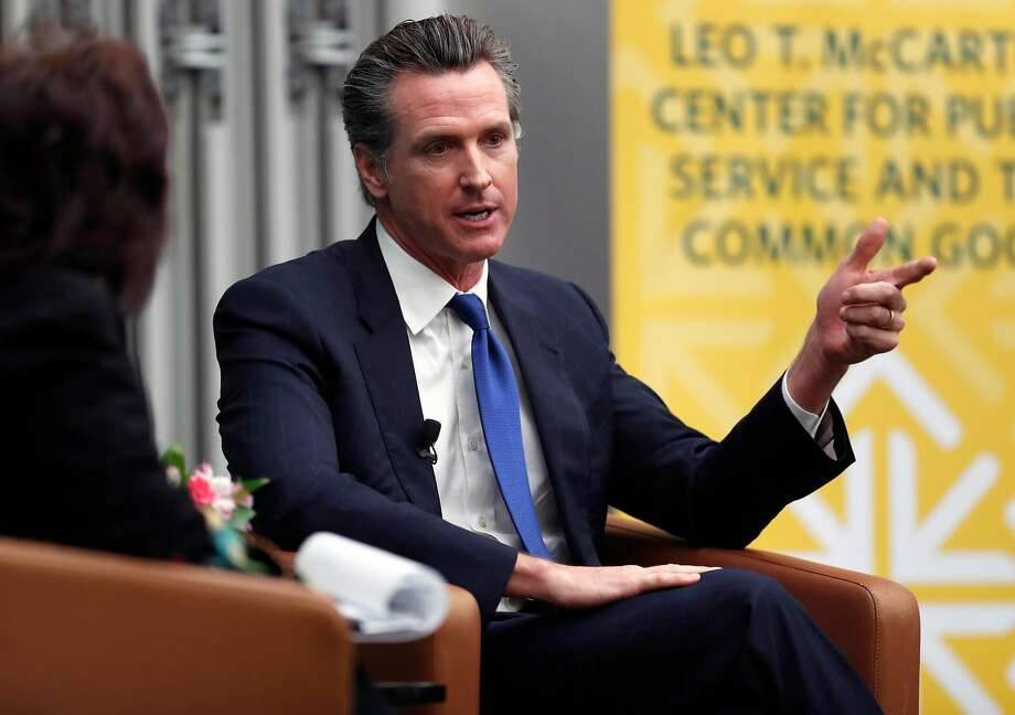 Gavin Newsom is interviewed by Politico's Carla Marinucci at a USF political event in February. Photo: Scott Strazzante / The Chronicle