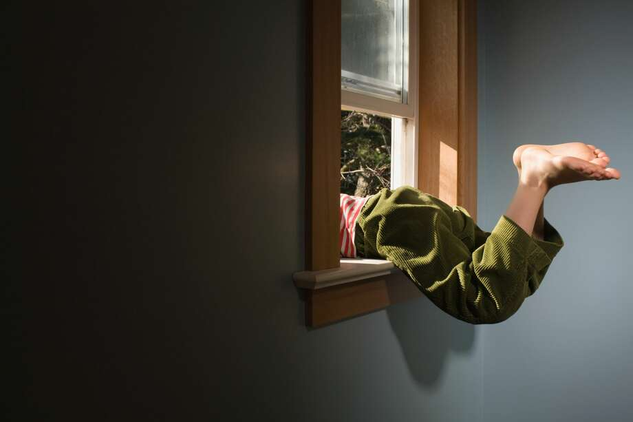 Boy climbing out of window Photo: Image Source/Getty Images/Image Source