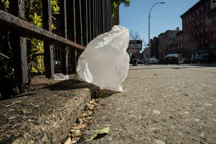 NEW YORK, NY - APRIL 23: A plastic bag blows down the street on Court Street, April 23, 2018 in the Brooklyn borough of New York City. New York Governor Andrew Cuomo introduced on Monday a bill that proposes to ban single-use carryout plastic bags statewide. If passed, the new law would go in effect in January of 2019. (Photo by Drew Angerer/Getty Images)