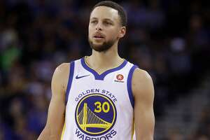 FILE - This March 6, 2018 file photo shows Golden State Warriors guard Stephen Curry during an NBA basketball game against the Brooklyn Nets in Oakland, Calif.  Sony Pictures Entertainment announced Monday, April 23, that it has struck a deal with the Golden State Warriors All-Star guard to produce television, film and possibly gaming projects. (AP Photo/Jeff Chiu, File)
