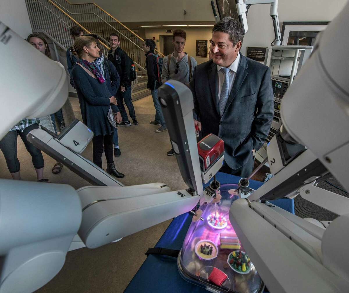 Dr. Richard Lazzaro, chief of thoracic surgery, Lenox Hill Hospital in New York, assisted in bringing in the da Vinci Robotic Surgical System instrument, which was on display at Union College on Monday, April 23, 2018, in Schenectady, N.Y. (Skip Dickstein/Times Union)