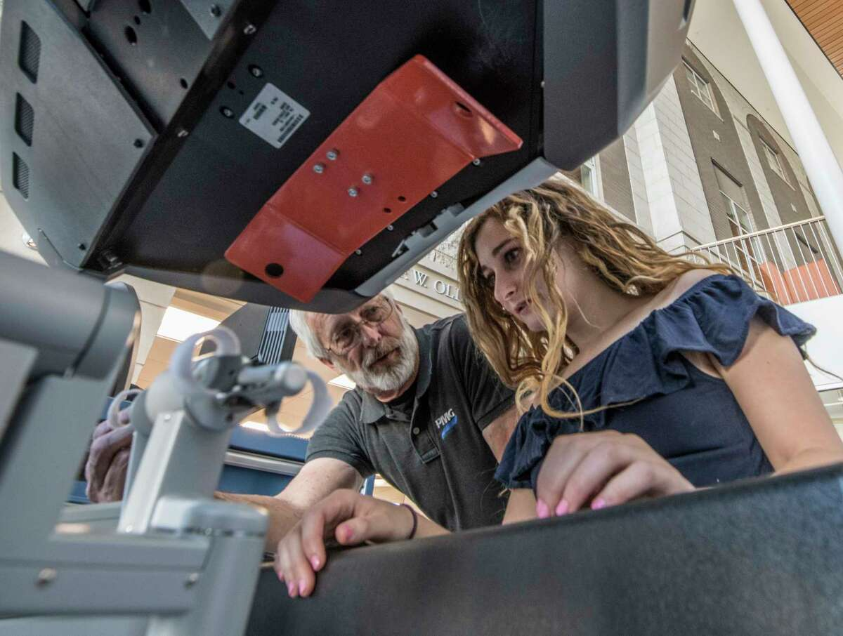 Sophomore Engineering student Mallory Epstein gets a primer on how to run the da Vinci Robotic Surgical System, which was on display at Union College on Monday, April 23, 2018, in Schenectady, N.Y. (Skip Dickstein/Times Union)