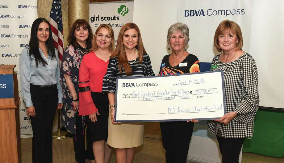 Rosa Cruz, Chacha Bravo, Vanessa Garcia, Minerva Santos, Carol Rausch and Lea Peacock pose for a photo as BBVA Compass donates $5,000 to the Girl Scouts of Greater South Texas on Thursday during the annual Power of the Purse event. The event — hosted by the Girl Scout Outreach Program — featured a unique silent auction with purses of all brands and on-trend styles as well as accessories, gift certificates and much more. Proceeds are used to increase program opportunities for girls in low-income areas who participate in the Girl Scout Outreach Program. Photo: Danny Zaragoza /Laredo Morning Times