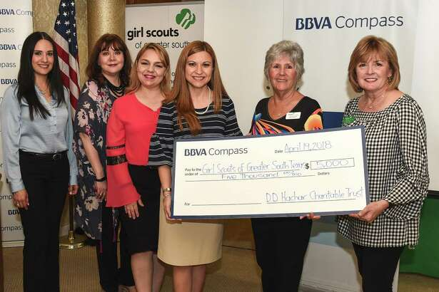 Rosa Cruz, Chacha Bravo, Vanessa Garcia, Minerva Santos, Carol Rausch and Lea Peacock pose for a photo as BBVA Compass donates $5,000 to the Girl Scouts of Greater South Texas on Thursday during the annual Power of the Purse event. The event — hosted by the Girl Scout Outreach Program — featured a unique silent auction with purses of all brands and on-trend styles as well as accessories, gift certificates and much more. Proceeds are used to increase program opportunities for girls in low-income areas who participate in the Girl Scout Outreach Program.