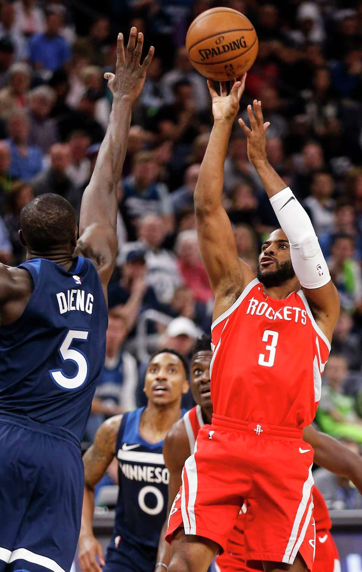Houston Rockets guard Chris Paul (3) taks a shot against Minnesota Timberwolves center Gorgui Dieng (5) during the first half of Game 4 of the first round of the NBA Playoffs at Target Center Monday, April 23, 2018 in Minneapolis.