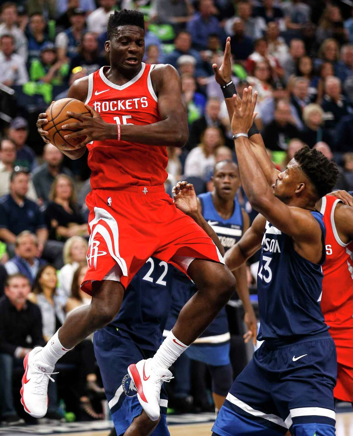 Houston Rockets center Clint Capela (15) grabs a rebound away from Minnesota Timberwolves guard Jimmy Butler (23) during the first half of Game 4 of the first round of the NBA Playoffs at Target Center Monday, April 23, 2018 in Minneapolis.
