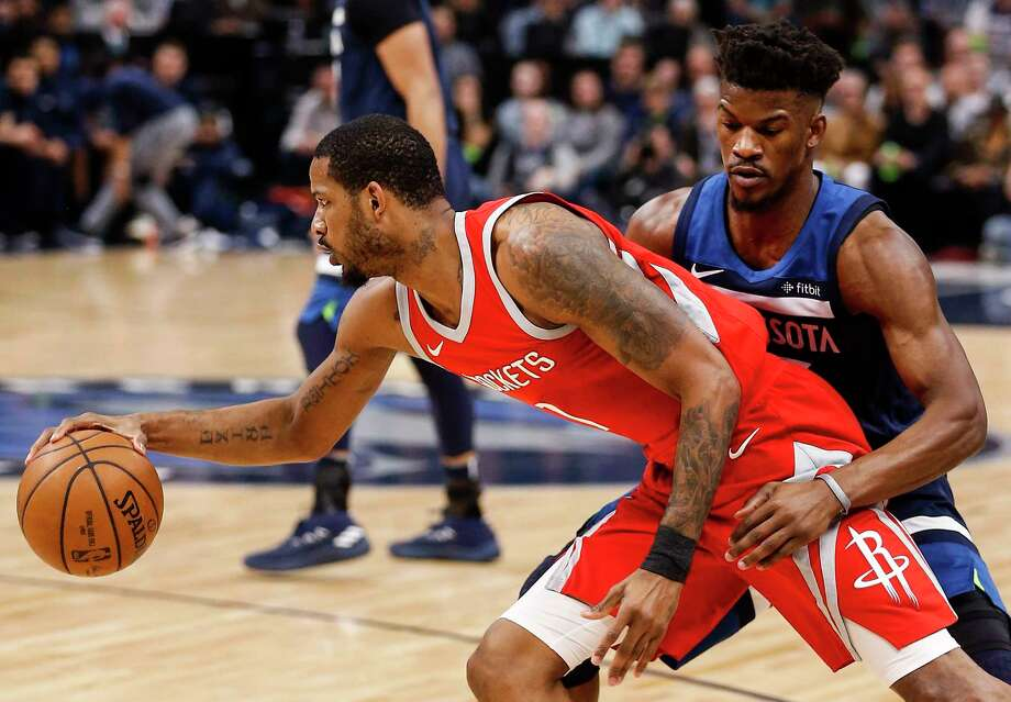 Houston Rockets forward Trevor Ariza (1) moves around Minnesota Timberwolves guard Jimmy Butler (23) during the first half of Game 4 of the first round of the NBA Playoffs at Target Center Monday, April 23, 2018 in Minneapolis. Photo: Michael Ciaglo, Houston Chronicle / Michael Ciaglo