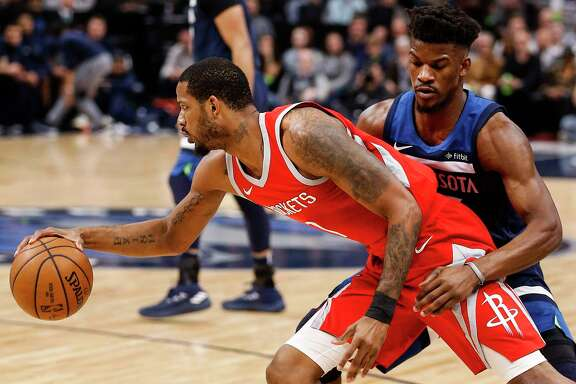 Houston Rockets forward Trevor Ariza (1) moves around Minnesota Timberwolves guard Jimmy Butler (23) during the first half of Game 4 of the first round of the NBA Playoffs at Target Center Monday, April 23, 2018 in Minneapolis.