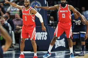 Houston Rockets guards Chris Paul (3) and James Harden (13) drop back on defense during the first half of Game 4 of the first round of the NBA Playoffs against the Minnesota Timberwolves at Target Center Monday, April 23, 2018 in Minneapolis.
