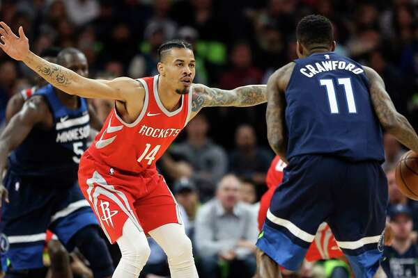 Houston Rockets guard Gerald Green (14) defends as Minnesota Timberwolves guard Jamal Crawford (11) brings the ball upcourt during the first half of Game 4 of the first round of the NBA Playoffs at Target Center Monday, April 23, 2018 in Minneapolis.