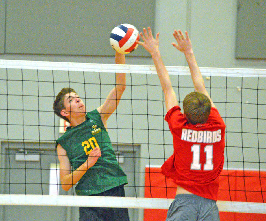 Metro-East Lutheran's Logan McDaniel, left, goes up for a kill during Monday's match at Alton.