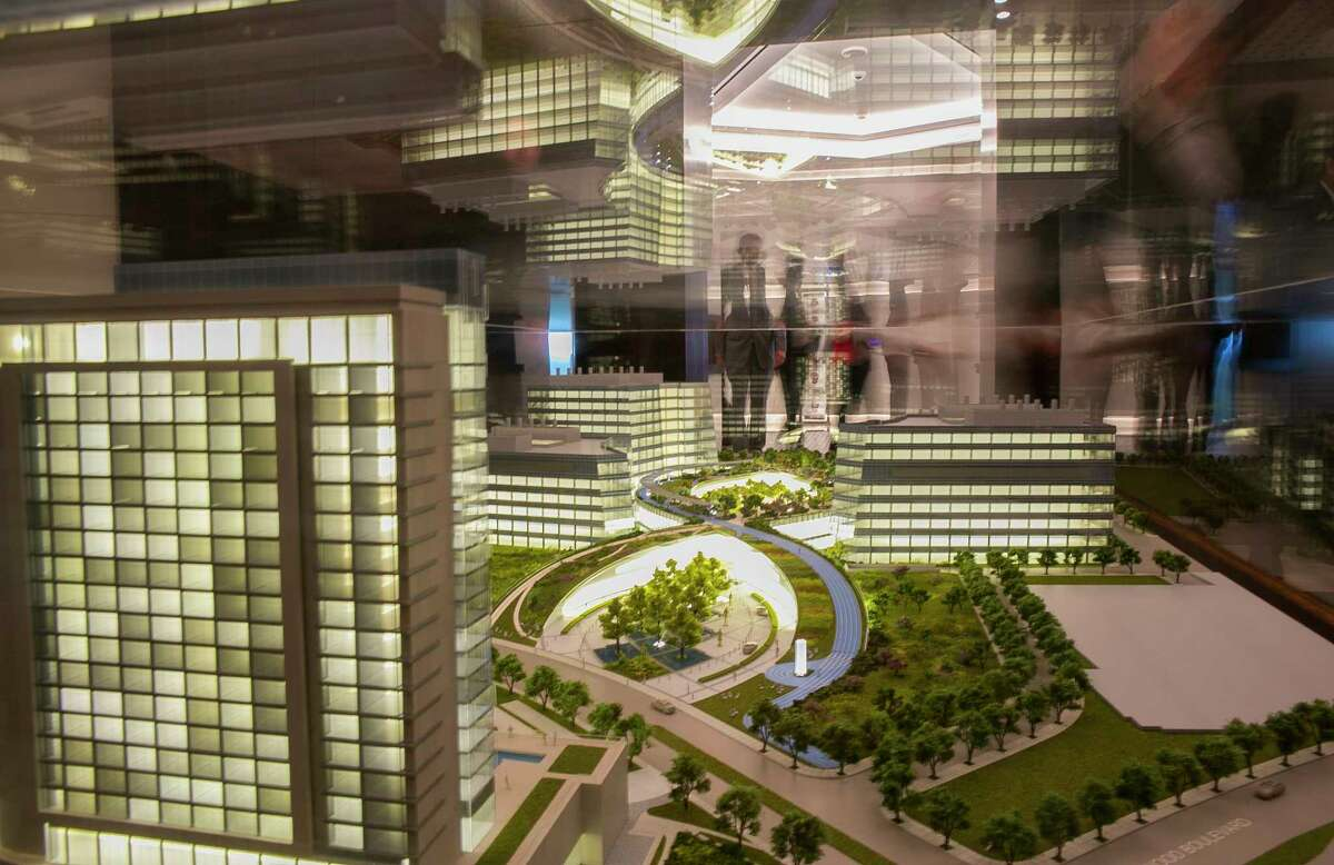 Visitors to the Texas Medical Center look at a model of the planned TMC3 innovation campus before a press conference announcing the plans by the Texas Medical Center, along with the Baylor College of Medicine, Texas A&M University, the University of Texas and M.D. Anderson Cancer Center, Monday, April 23, 2018, in Houston.