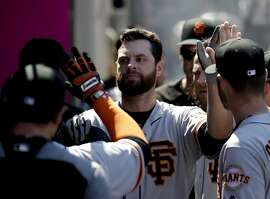San Francisco Giants' Brandon Belt celebrates in the dugout after his home run against the Los Angeles Angels during the fifth inning of a baseball game in Anaheim, Calif., Sunday, April 22, 2018. (AP Photo/Chris Carlson)