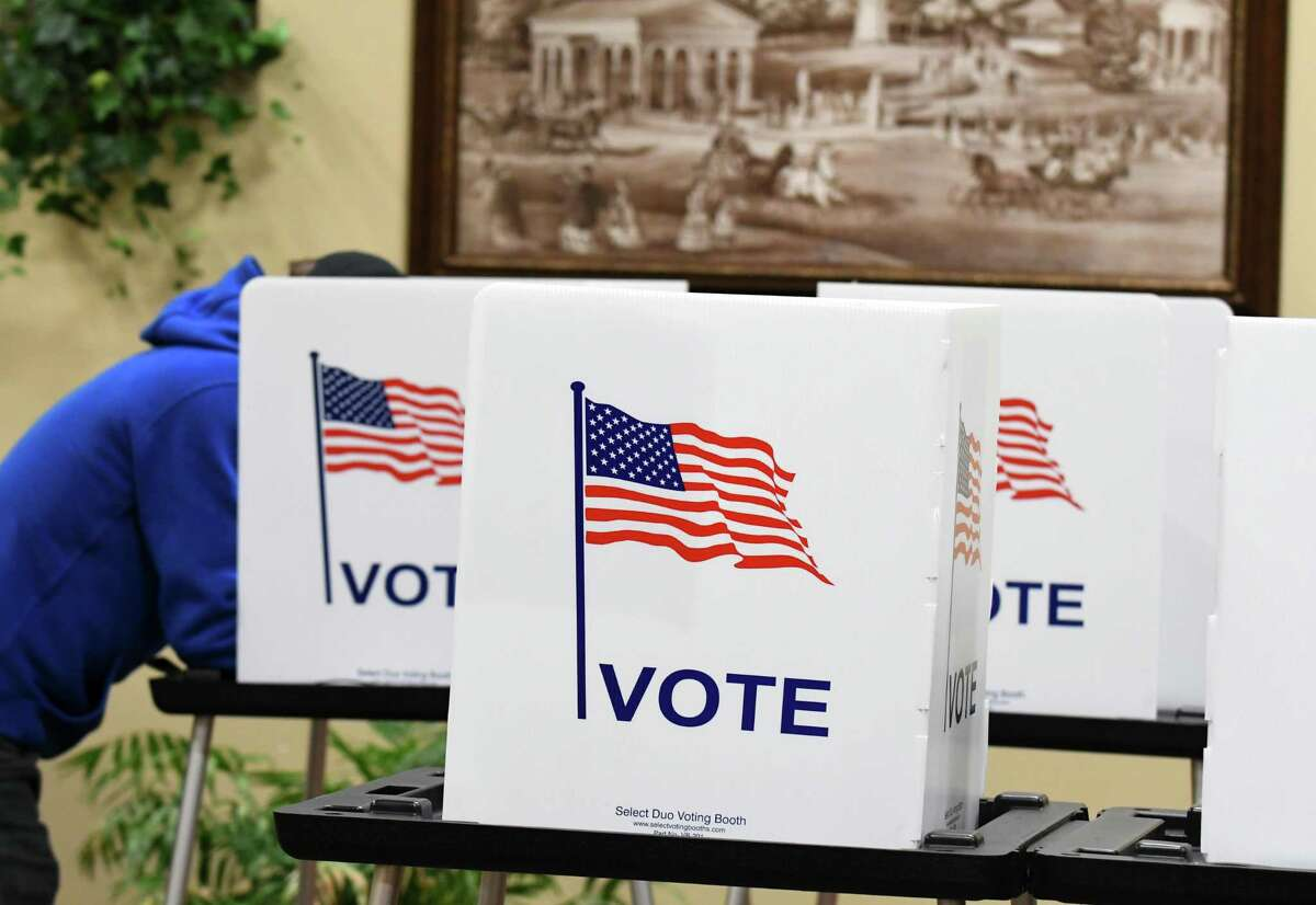 FILE. Saratoga Springs voters fill out ballots at the Canfield Casino polling place on Tuesday, Nov. 7, 2017, in Saratoga Springs, N.Y. (Will Waldron/Times Union)