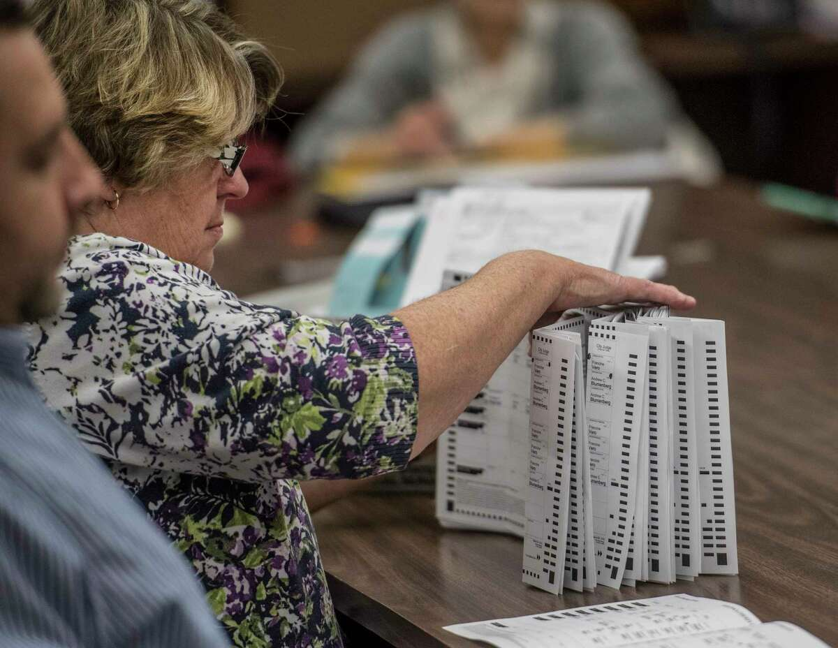 The recount of absentee ballots in the City of Saratoga election continues as a closer look is made of the City Charter vote and the race for the Public Safety Commissioner Tuesday Nov. 14, 2017 at the Saratoga County Board of Elections offices in Ballston Spa, N.Y. (Skip Dickstein/ Times Union)