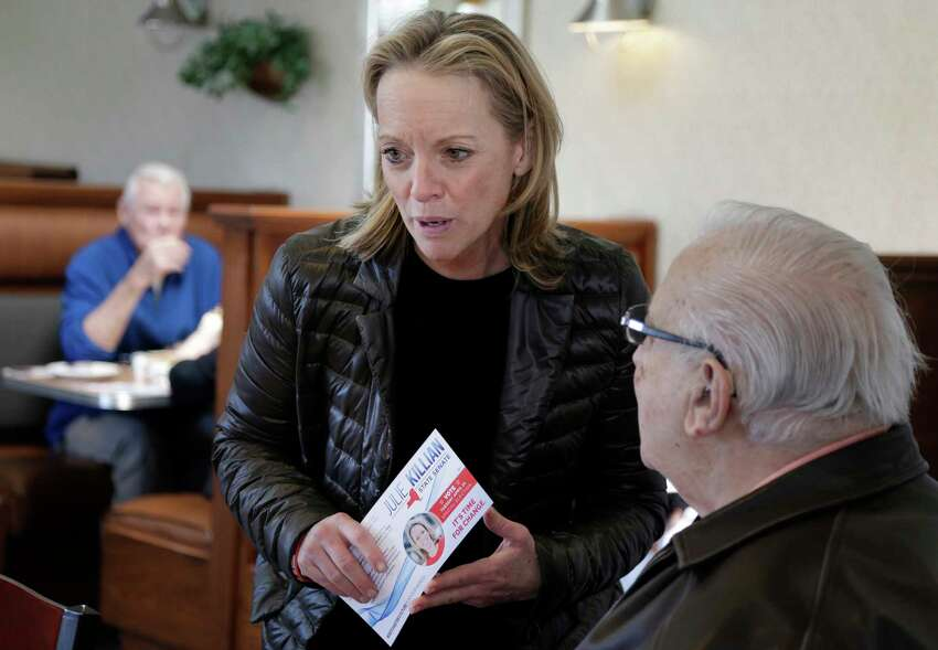 Republican Julie Killian, center, talks to people in a diner while campaigning in Eastchester, N.Y., Monday, April 23, 2018. Voters in Democrat-leaning districts in Westchester County and the Bronx will head to the polls Tuesday to fill two vacant state Senate seats. In Westchester, Killian faces Democratic Assemblywoman Shelley Mayer in what is expected to be a close race and could decide which party controls the state Senate. (AP Photo/Seth Wenig)