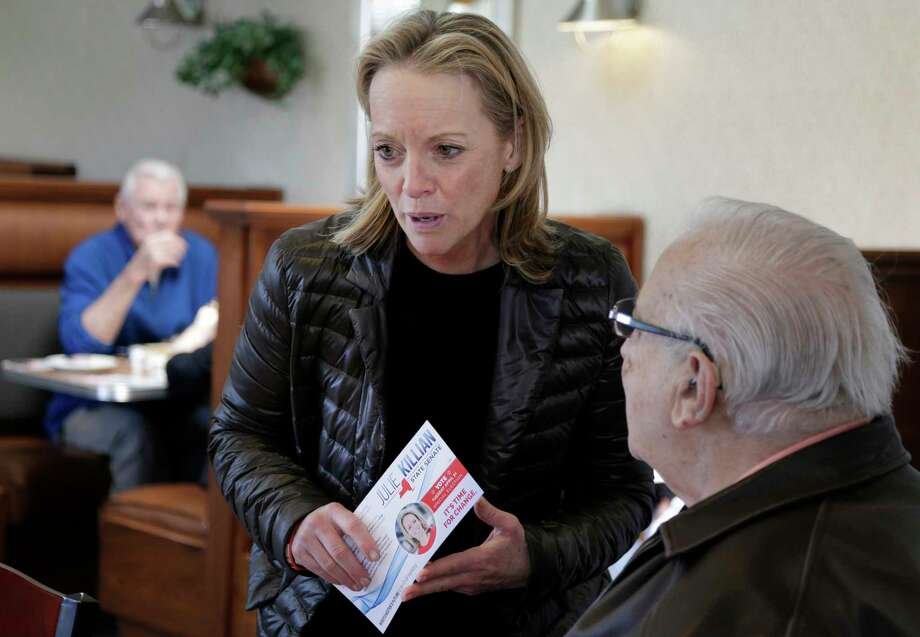 Republican Julie Killian, center, talks to people in a diner while campaigning in Eastchester, N.Y., Monday, April 23, 2018. Voters in Democrat-leaning districts in Westchester County and the Bronx will head to the polls Tuesday to fill two vacant state Senate seats. In Westchester, Killian faces Democratic Assemblywoman Shelley Mayer in what is expected to be a close race and could decide which party controls the state Senate. (AP Photo/Seth Wenig) Photo: Seth Wenig / AP
