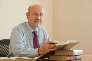 Judge Richard Ulmer in his law library.  Photo courtesy of Judge Ulmer campaign