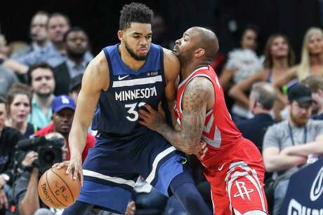 Houston Rockets forward PJ Tucker (4) defends against Minnesota Timberwolves center Karl-Anthony Towns (32) during the second half of Game 4 of the first round of the NBA Playoffs at Target Center Monday, April 23, 2018 in Minneapolis.