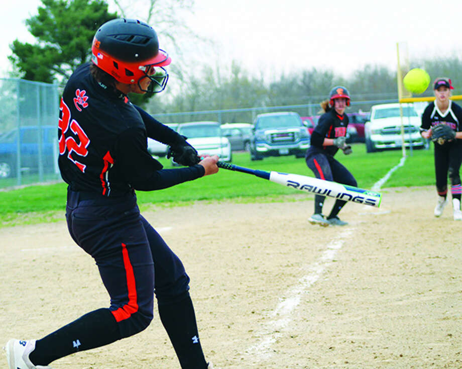 Edwardsville's Maria Smith hits an RBI double during the fourth inning against Hardin Calhoun on Monday.