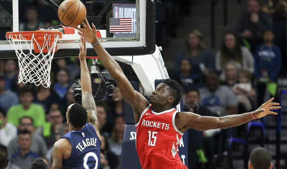 The Rockets' Clint Capela (15) blocks a shot by the Timberwolves' Jeff Teague for part of a stat-stuffing night that featured 14 points, 17 rebounds and four blocks. Photo: Michael Ciaglo, Houston Chronicle / Houston Chronicle / Michael Ciaglo
