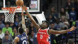 The Rockets' Clint Capela (15) blocks a shot by the Timberwolves' Jeff Teague for part of a stat-stuffing night that featured 14 points, 17 rebounds and four blocks.