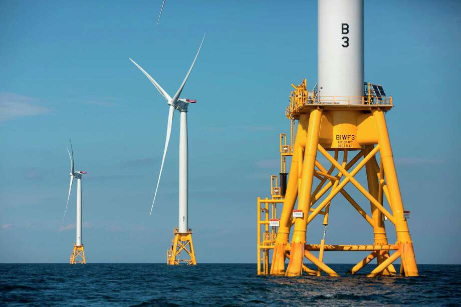 FILE - In this Aug. 15, 2016, file photo, three of Deepwater Wind's turbines stand in the water off Block Island, R.I. Using federal offshore leases, wind power projects along the East Coast are pressing ahead in 2018, with the goal of transforming the electric grid and providing energy to power millions of homes. (AP Photo/Michael Dwyer, File) Photo: Michael Dwyer / Copyright 2018 The Associated Press. All rights reserved.