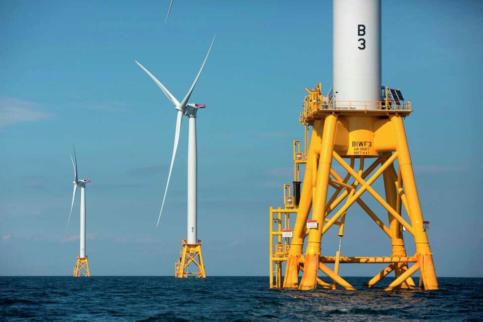 FILE - In this Aug. 15, 2016, file photo, three of Deepwater Wind's turbines stand in the water off Block Island, R.I. Using federal offshore leases, wind power projects along the East Coast are pressing ahead in 2018, with the goal of transforming the electric grid and providing energy to power millions of homes. (AP Photo/Michael Dwyer, File)