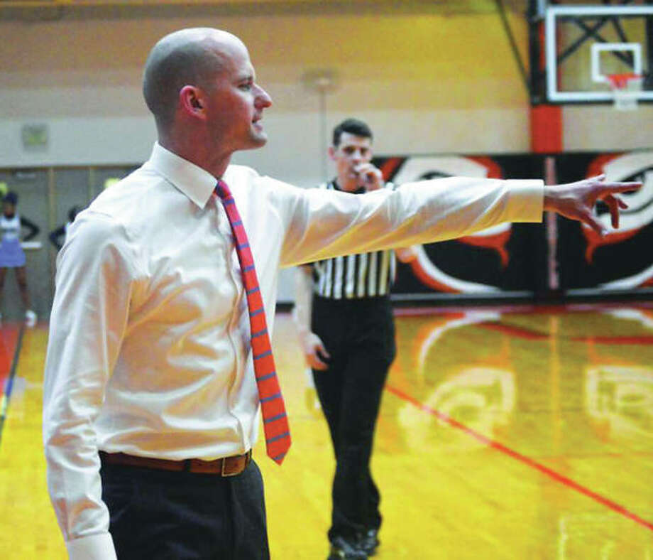 Dustin Battas, shown directing the Tigers junior varsity during a game last season, on Monday night was named Edwardsville boys basketball head coach the the district's board. He replaces Mike Waldo, who was let go after 30 seasons with a 646-215 record with the Tigers. Photo:       Hearst File Photo