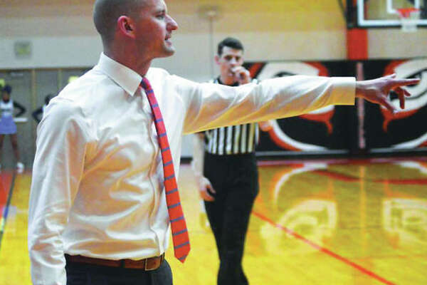 Dustin Battas, shown directing the Tigers junior varsity during a game last season, on Monday night was named Edwardsville boys basketball head coach the the district's board. He replaces Mike Waldo, who was let go after 30 seasons with a 646-215 record with the Tigers.