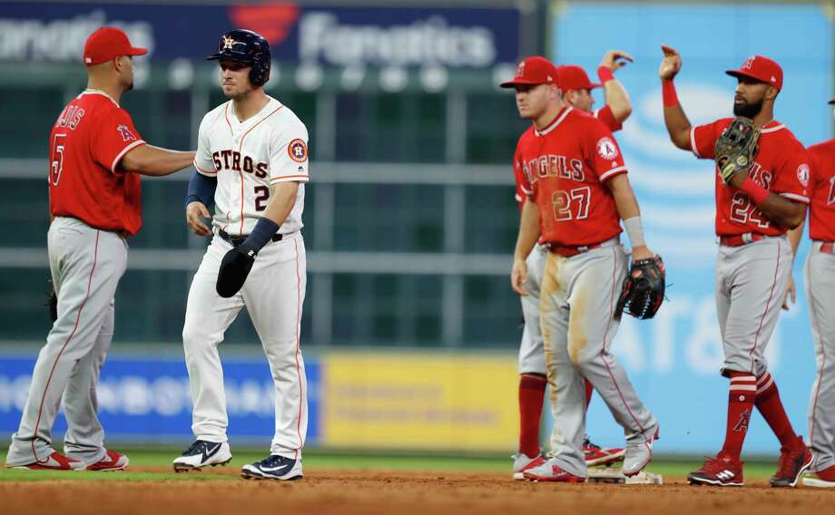 Houston Astros Alex Bregman (2) exchanges words with Los Angeles Angels  Albert Pujols (5) after Yuli Gurriel was called out at third base after an MLB game at Minute Maid Park, Monday, April 23, 2018, in Houston. Photo: Karen Warren, Houston Chronicle / © 2018 Houston Chronicle