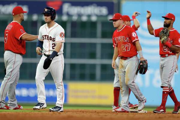 Houston Astros Alex Bregman (2) exchanges words with Los Angeles Angels  Albert Pujols (5) after Yuli Gurriel was called out at third base after an MLB game at Minute Maid Park, Monday, April 23, 2018, in Houston.