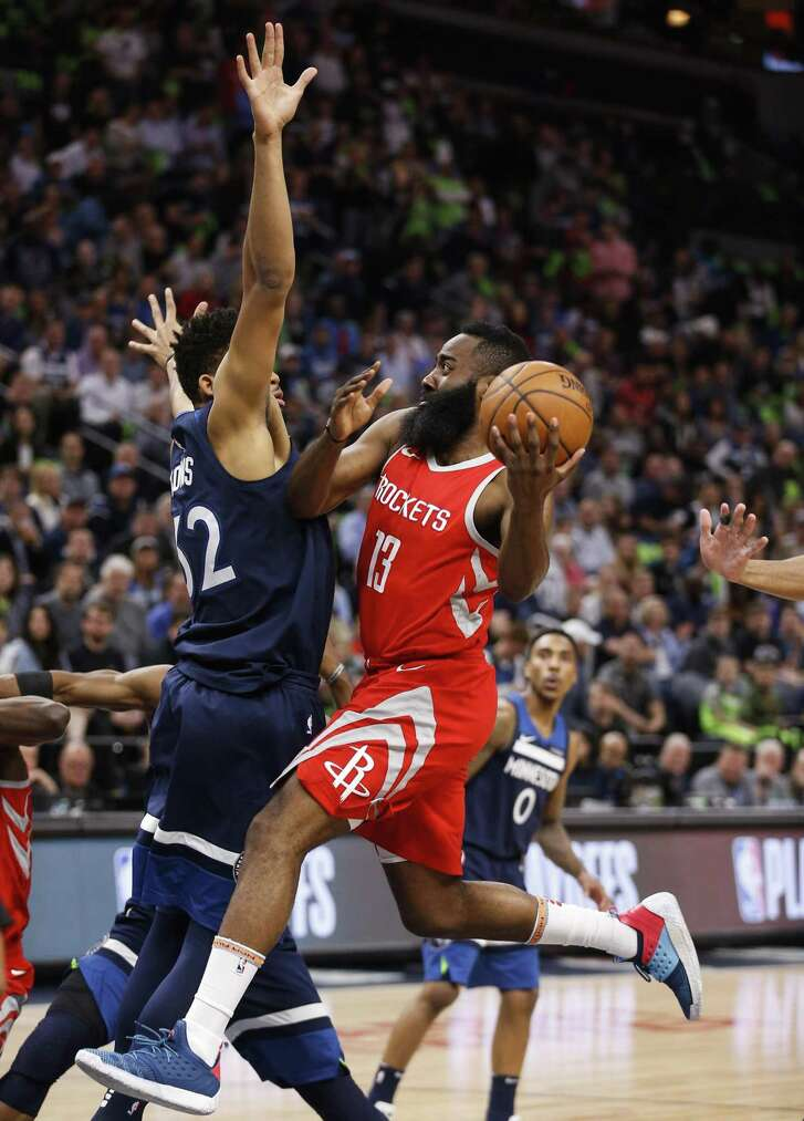 Houston Rockets guard James Harden (13) drives to the basket agaisnt Minnesota Timberwolves center Karl-Anthony Towns (32) during the first half of Game 4 of the first round of the NBA Playoffs at Target Center Monday, April 23, 2018 in Minneapolis. (Michael Ciaglo / Houston Chronicle)