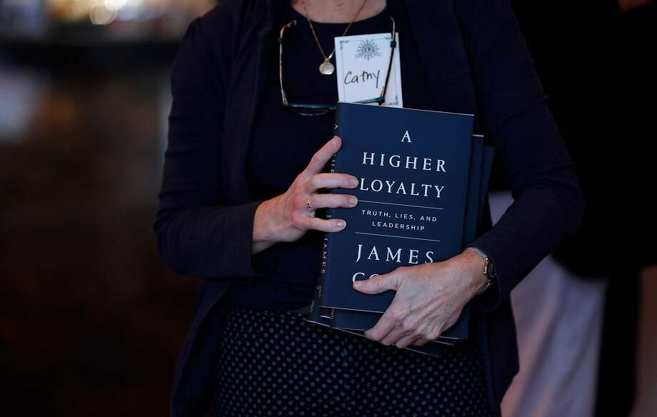 "Cathy Rath holds copies of former FBI Director James Comey's new book, ""A Higher Loyalty: Truth, Lies, and Leadership,"" for theater patrons before Comey appeared at the Curran Theater. Photo: Carlos Avila Gonzalez / The Chronicle"