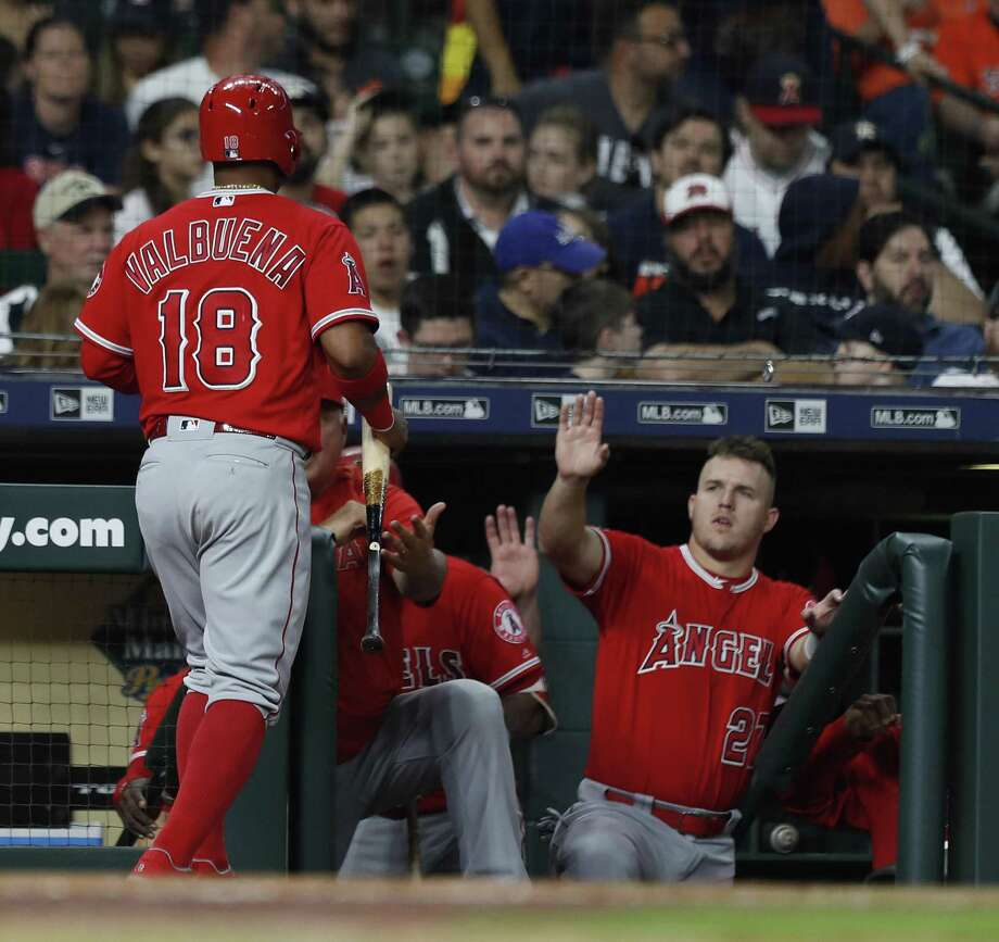 Former Astro Luis Valbuena is greeted by Mike Trout, right, after returning to the Angels' dugout in the fifth inning with Monday night's first run. Photo: Karen Warren, Staff / Houston Chronicle / © 2018 Houston Chronicle