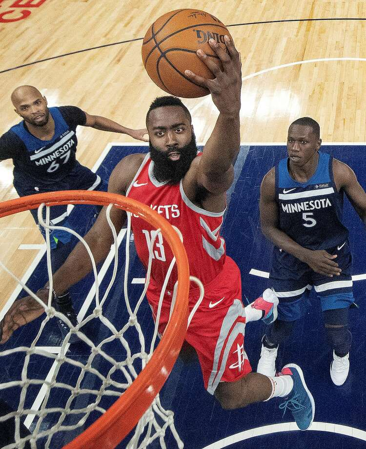The Rockets' James Harden heads to the hoop in the first half, when his team was not shooting well. That changed after halftime. Harden scored 22 of Houston's 50 points in the third quarter. Photo: Carlos Gonzalez / Minneapolis Star Tribune