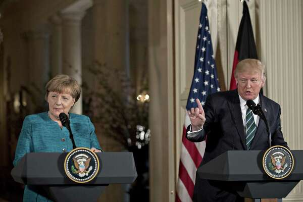 President Donald Trump speaks as German Chancellor Angela Merkel (left) listens during a news conference at the White House in Washington on March 17, 2017.