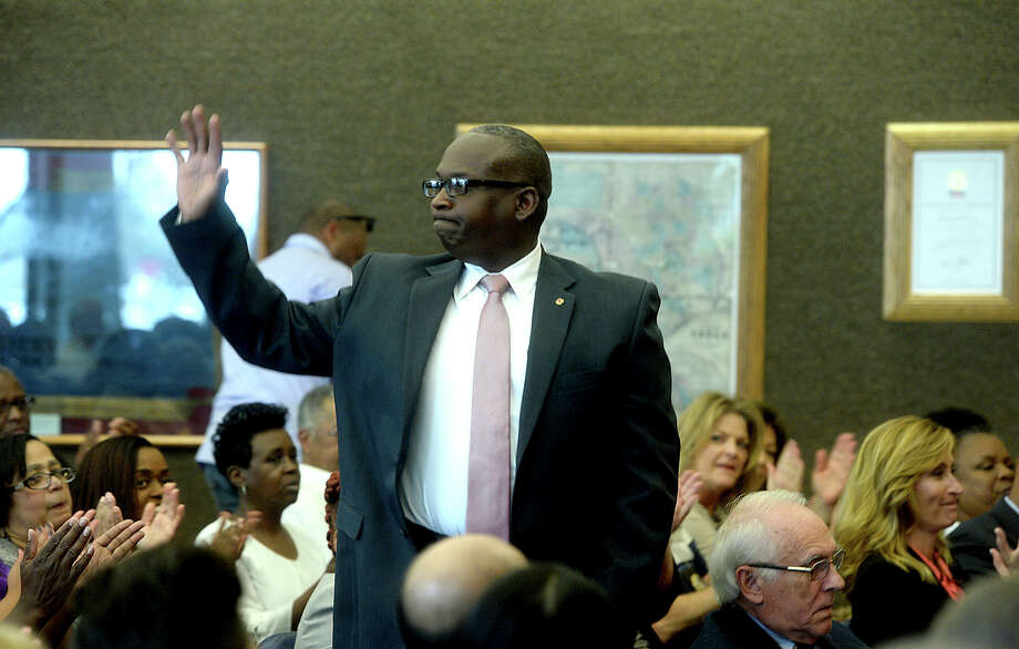 Fire Marshal Earl White waves to the large crowd before being sworn into office as Precinct 1 Constable by Judge Larry Thorne during Commissioners Court in the Jefferson County Courthouse Monday. Precinct 1 Constable Nick Saleme submitted his resignation following his loss in last Tuesday's primary election, and his resignation was unanimously accepted before White's appointment was approved and the swearing-in ensued.  Photo taken Monday, March 7, 2016 Kim Brent/The Enterprise Photo: Kim Brent Kim Brent / Beaumont Enterprise