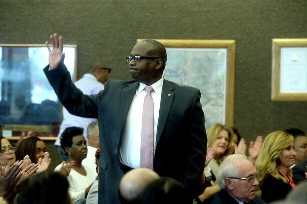 Fire Marshal Earl White waves to the large crowd before being sworn into office as Precinct 1 Constable by Judge Larry Thorne during Commissioners Court in the Jefferson County Courthouse Monday. Precinct 1 Constable Nick Saleme submitted his resignation following his loss in last Tuesday's primary election, and his resignation was unanimously accepted before White's appointment was approved and the swearing-in ensued.  Photo taken Monday, March 7, 2016 Kim Brent/The Enterprise
